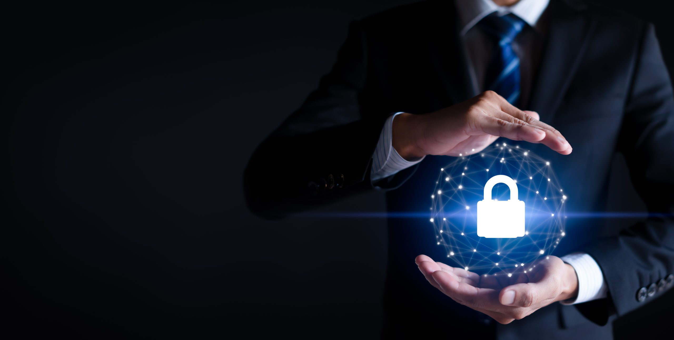 Cybersecurity and information technology security services concept. Businessman with protective gesture Lock icon to protect the security, copy space